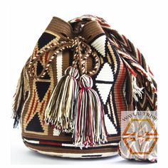 Visit www.Wayuutribe.com to see more Mochilas and boho bags styles. These bags are known as the Susu bag to the Wayuu people. The average bag takes 10-20 days to hand weave. All bags are Handmade. Wayuu people are use bight different colors and patterns to tell the story of the weaver. These are all one-of-kind bags. Wayuu tribe bags are $148.00. They are woven with cotton thread. A nice beach bag or farmer bag that is very sturdy. #boho #HANDMADE #mochila @Racked