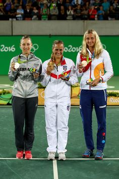 L-R) Silver medalist Angelique Kerber of Germany, gold medalist Monica Puig of Puerto Rico and bronze medalist Petra Kvitova of the Czech Republic pose during the medal ceremony for Women's Singles on Day 8 of the Rio 2016 Olympic Games at the Olympic Tennis Centre on August 13, 2016 in Rio de Janeiro, Brazil.