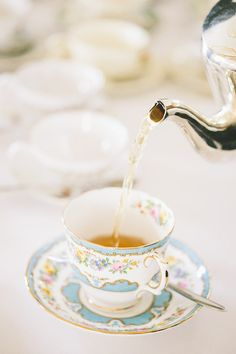 Tea pouring into a cup stock photo - OFFSET