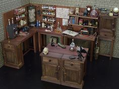 Mad Scientist's Lab - A 1/6th scaled mix of scratch-built balsa wood tables and miniature key cabinets from a craft store. A proper floor and walling is next on the list!