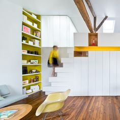 SABO Project transforms Paris apartment with multicoloured flooring and space-saving stairs