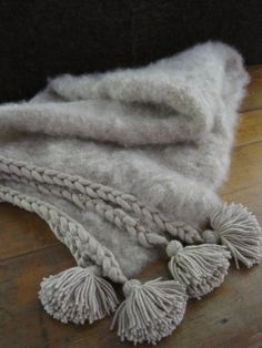 Fluffy mohair with thick plait and pompom tassels