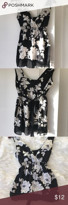 WHBM silk top White and gray flowers on a black background. Silk but may be washed on gentle. Sheer black at bottom and pretty bow that ties in back. White House Black Market Tops Blouses
