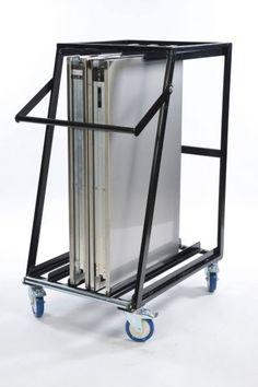 Transportwagen TraiteurTafel Multi Herman Mengede.  Afmetingen: H-120cm; D-87cm; B-62cm. Gewicht: 30kg. Kleur: Zwart. Geschikt voor 1 tot 5 MultiTafels, MultiTafels.  Gelagerde roestvrijstalen transportrol in verband met het inrijden van de tafels. 2 Geremde bokwielen en veiligheidsbrug voor het vastzetten van de tafels. Transportbox voor het opbergen van rokken of materialen. Door gebruik te maken van deze Transportwagen voorkomt u onnodige beschadigingen aan uw tafels.