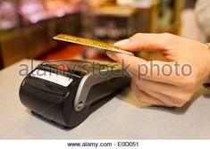 Female paying credit card shop butcher - Stock Photo