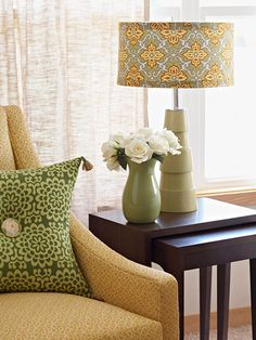Spice up your lamp's shade by using a fun piece of fabric.
