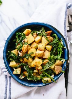 Roasted broccoli rabe and potatoes with a zippy dressing make a great side dish (or breakfast hash!) - cookieandkate.com