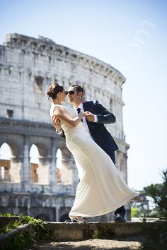 Wedding couple photographed at the Roman Colosseum in Rome Italy by Andrea Matone #photographer