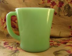 Fire-King Anchor-Hocking Jadeite mug. Fire-King is a collectible brand of glassware manufactured by the Anchor-Hocking Glass Company of Lancaster, Ohio. Jadite or Jade-ite is the popular milky-green color of this vintage brand of glassware which is similar to Pyrex and marketed as Ovenware.  The most common Jadite products being cups, mugs, plates, dishes and bowls.