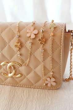 Chanel Handbag. Flower detail straps. I need this in my life. Christmas 2015?