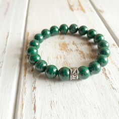 Genuine Malachite Bracelet w/ Sterling Silver Charm  Malachite is a stone of manifestation, balance and abundance. If the wearer is going through