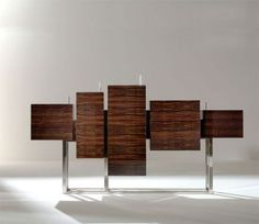 Modern sideboard ideas | modern sideboard/console table. It still gives plenty of storage, but it seems to be rather a sculpture then a furniture piece.  |www.bocadolobo.com #modernsideboard #sideboardideas
