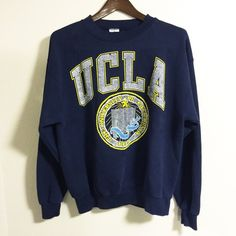 UCLA sweatshirt Vintage UCLA sweatshirt. Navy blue with yellow print. 50% cotton and 50% polyester. Men's large, but it's a unisex sweatshirt. I wore it loose and baggy. Vintage Sweaters Crew & Scoop Necks