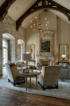 Wood beams add such warmth.  I am always drawn to elegance being anchored by rustic features such as the beams, floors, worn chandelier and stone walls!