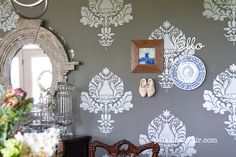 DIY stenciled walls - I'm thinking about stenciling semi-gloss paint on flat paint in the same color in my living room.  I love it already!