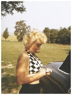 Another photo from that set taken by Eve Arnold.  Marilyn eating what looks like a pear.