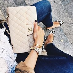 Chanel / can't go wrong with a creme purse this season.