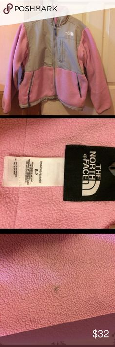 North Face fleece jacket Pink North Face Fleece Jacket. It is several years old, but still in very wearable condition. It has a few marks on one of the sleeves and shows some wear-and-tear around the cuffs. Other than that, it is super comfortable and warm. North Face Jackets & Coats