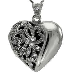 """Heart Shape Vintage Diamond Locket -  This vintage style diamond heart locket pendant is adorned with 0.20cts of brilliant round diamonds. This heavy heart shaped locket is set with diamonds and comes with a 16"""" chain. This antique diamond locket is very substantial and very well-made. When we make our diamond lockets we are careful to produce pieces with a heavy metal weight, which insures that they will give many years of trouble-free wear.  Dacarli has been manufacturing diamond..."""