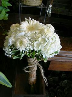 White Hydrangea, White Dahlias, White Gerbera Daisies, White Gypsophila, Green Foliage Hand Tied With Burlap Wedding Bouquet