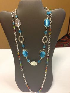 """Blue Taffy"" - 27"" Bursts of blue cats-eye beads mingled with silver hoops and multi-dimensional discs make this vibrant necklace a favorite http://HookedOn.Mialisia.com"