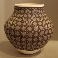 Pueblo:  Acoma  Artist:  Amanda Lucario   Date Created: 2013  Dimensions:  5 1/2 in H by 5 1/2 in Dia   Item Number:  xxach3181  Price:  $ 1100 Description:  Fine line and geometric design