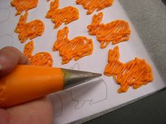 Tracing shapes on wax paper with candy melts to create decorations for cupcakes etc