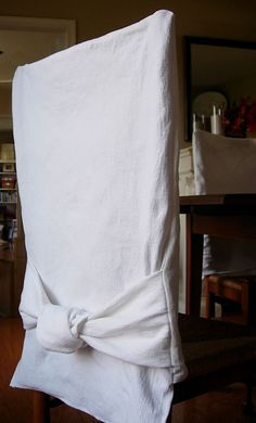 Very simple, how to slipcover a dining chair. DIY tutorial from In My Own Style blog.