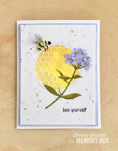 Hello everyone! Today I have a card for you featuring some new products from the Memory Box Spring 2018 release. To create this card I die cut the Honeycomb Stitched Circle Frame in the center of white cardstock. Next I die cut the Sweet Honeybee and Forget Me Not Blooms from watercolor paper and painted them. I also painted a piece of watercolor paper to place behind the die cut honeycomb circle. I spattered the white cardstock layer, that the honeycomb was die cut from, with black paint…