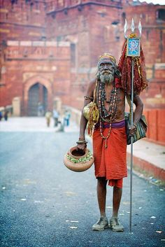 Sadhu in front of the red fort in Agra, India