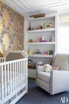 Gemma's serene bedroom features Fornasetti wallpaper, Dwell Studio's two-tone Vanderbilt crib, and a Jennifer Delonge chair   archdigest.com