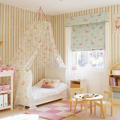 Update your nursery into a bedroom by introducing striped wallpaper and a butterfly blind from Osborne & Little and a matching voile canopy. Introduce a cot that will transform into a bed and a play table and chairs from Ikea. The adorable dolls' house shelf finishes off the style.