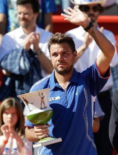 Switzerlands Stanislas Wawrinka holds his trophy after winning the Portugal Open final tennis match with Spains David Ferrer Sunday, May 5 2013, in Oeiras, outside Lisbon. Wawrinka defeated Ferrer 6-1, 6-4.(AP Photo/Armando Franca) 	Next