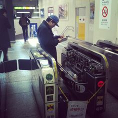 Fixing a ticket gate. A fairly common site in Japan
