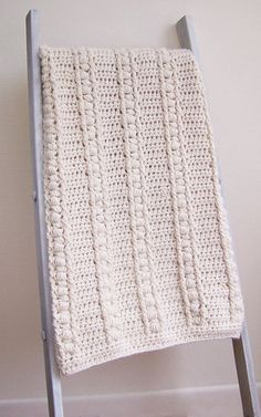 ** This Listing is for a Crochet Pattern Only **  Sweet Haven Baby Blanket PDF Crochet Pattern  Crochet this super-snuggly baby blanket, full of warmth and beautiful texture. Surrounded by a soft border of simple stitches, the faux cable-like details provide a unique blanket for the nursery or for your little one to tote around.  Blanket pattern uses bulky weight yarn. Drops Andes used for blanket in photos.  Baby Blanket Size: Approximately 42 x 30 in (107 x 76 cm). Perfect for a new baby…