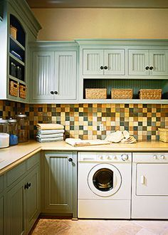 Beautiful cabinets and tile work.