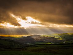 Fingers of light break through the clouds above Lowick in the South Lakes. This was taken on a very wet and boggy descent from Bethecar Moor.  Rob Sutherland