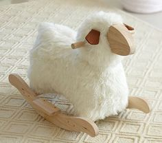 Sheep Rocker #PotteryBarnKids $129.00 Maybe I could put some horns on this guy and pretend its a goat. Goat rockers are few and far between.