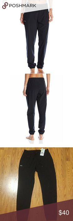 Women's Under Armour easy studio pant New With tags. Originally  $60  Color- black  Size XS  Soft, lightweight woven fabric delivers superior comfort & durability. Signature Moisture Transport System wicks sweat to keep you dry & light. Classic jogger construction flows from a more generous hip & thigh to a slim, fitted ankle. Rubber snap closure with zip fly & drawcord for a secure fit. Open hand pockets. Under Armour Pants