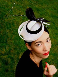 LOLA - small pinok-pok beret with pinok-pok sculpted ribbons and a curled tigered quill. GBP 255.00.