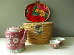Antique Chinese tea set in a padded rattan warming basket.