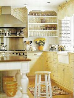 Love this soft yellow kitchen!