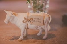 Plastic farm animals are spray painted white and used as place cards in this #rustic #barn #wedding // Photography by Popcorn Photography.