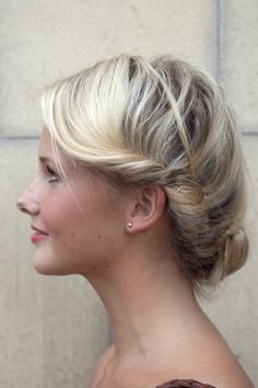 A simple way to do a twisted bun — straight from Stockholm fashion week