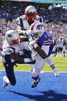 Buffalo Bills wide receiver Steve Johnson (13) catches a touchdown pass from EJ Manuel in front of New England Patriots' Devin McCourty (32) and Kyle Arrington (25) during the second half of an NFL football game on Sunday, Sept. 8, 2013, in Orchard Park. (AP Photo/Bill Wippert)