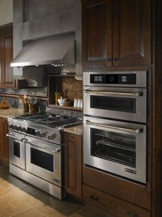 """Jenn-Air kitchen with 48"""" gas range and wall oven with dark cabinets"""