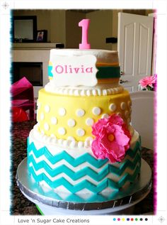 Chevron cake! Turquoise, pink, and yellow chevron theme cake for my daughters 1st (first) birthday! All buttercream with fondant accents! Ideas from Pinterest! Made by me!