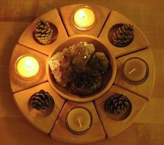 i like this concept for the advent wreath.  i might have the hubs make me something like this.