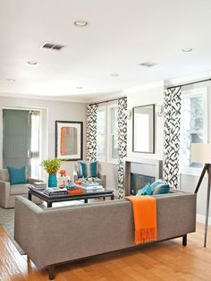 black and white curtains, blue and orange accents