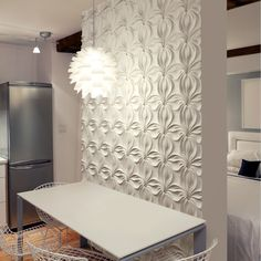 Interesting alternative to wallpaper or faux stone - architectural wall panels.